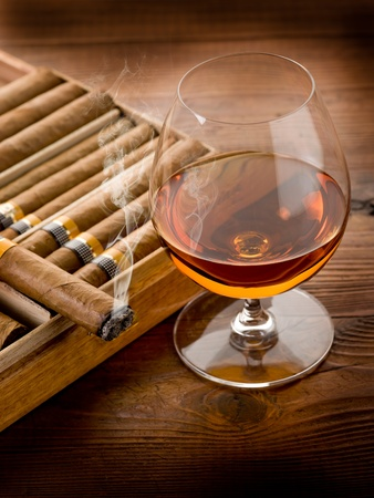 cognac: cuban cigar and cognac on wood background Stock Photo