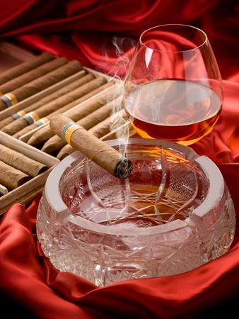 drunks: Cuban cigar and liquor over the ash tray