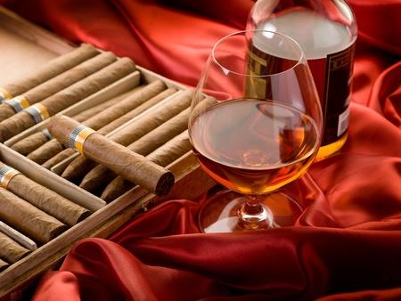 cuban cigar and  liquor  over red satin Stock Photo - 10426671
