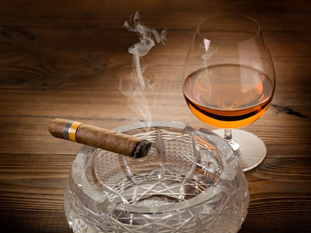 cigars: cuban cigar and cognac on wood background Stock Photo