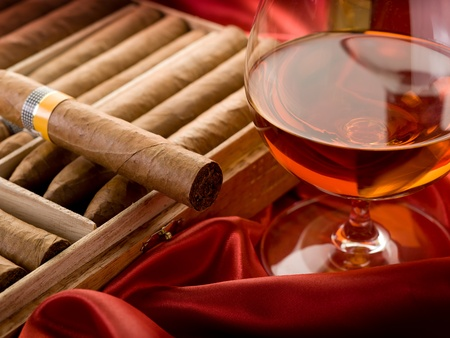 drunks: cuban cigar and  liquor  over red satin