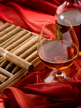 cuban cigar and  liquor  over red satin Stock Photo - 10426668