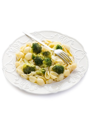 orecchiette with broccoli on dish over white photo