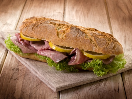steak sandwich: sandwich with roastbeef lettuce and slice lemon