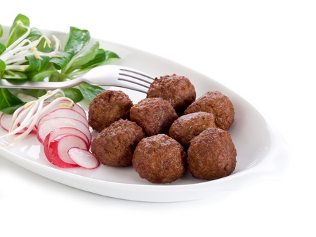 balls deep: vegetarian meatballs with slice radish, soy sprout and salad