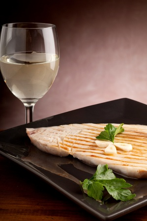 grilled swordfish with garlic and parsely photo
