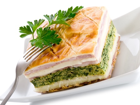 quiche with ham cheese and spinach photo