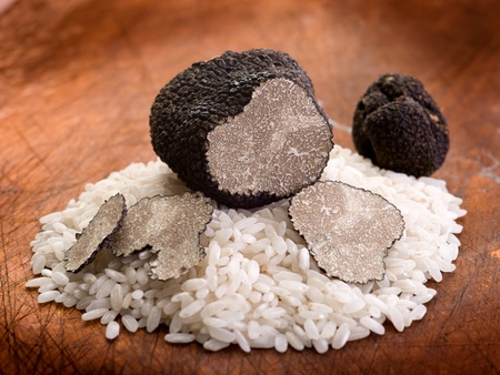 sliced black truffle over wood background Stock Photo - 10436295