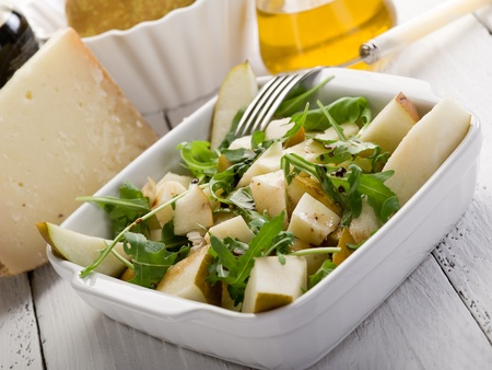 arugola: cheese and pears salad with baslamic vinegar and olive oil
