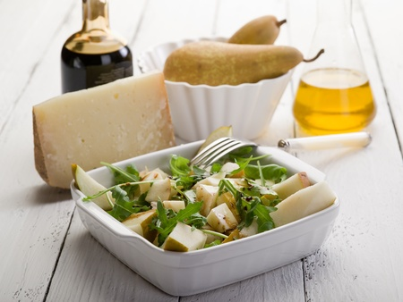 beautiful salad: cheese and pears salad with baslamic vinegar and olive oil