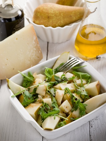 salad dressing: cheese and pears salad with baslamic vinegar and olive oil