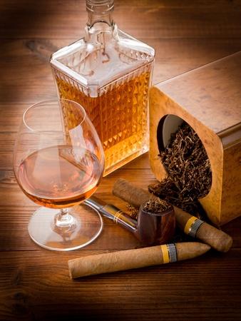 drunks: pipe tobacco cuban cigar and liquor Stock Photo