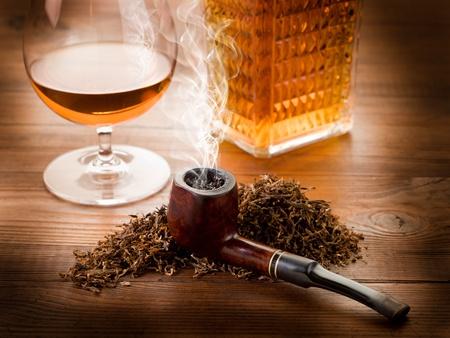 smoking pipe, tobacco  and liquor photo