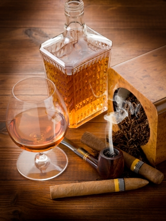 whiskey glass: pipe tobacco cuban cigar and liquor Stock Photo