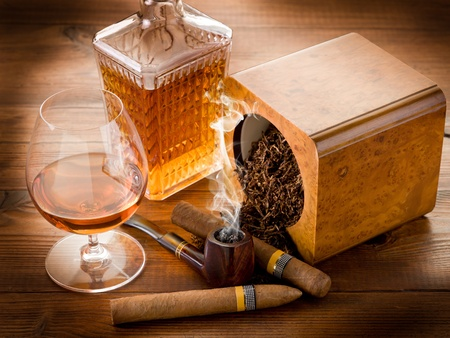 man smoking: pipe tobacco cuban cigar and liquor Stock Photo