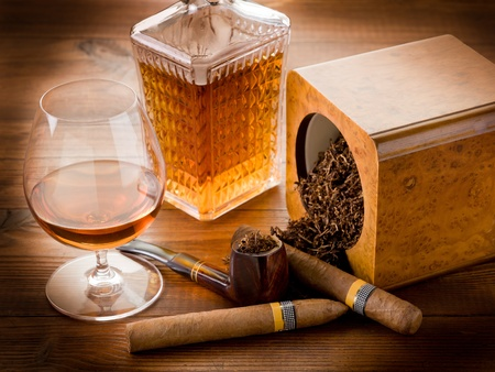 cigar smoking man: pipe tobacco cuban cigar and liquor Stock Photo