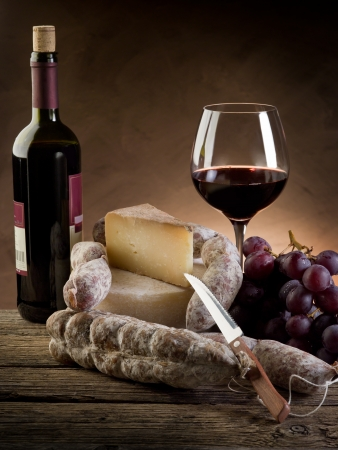 french food: cheese salami grapes and red wine
