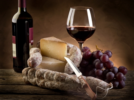 wine food: cheese salami grapes and red wine