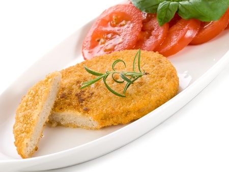 whitw: slice vegetarian cutlet with slice tomatoess