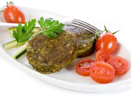 croquettes: vegetarian spinach croquettes with tomatoes Stock Photo