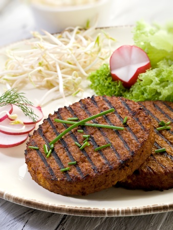 vegetarian hamburger: vegetarian hamburger with soy sprout radish and salad Stock Photo