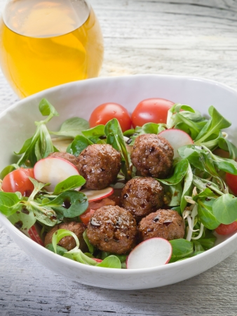 balls deep: mixed salad with vegetarian meatballs slice radish and  soy sprout