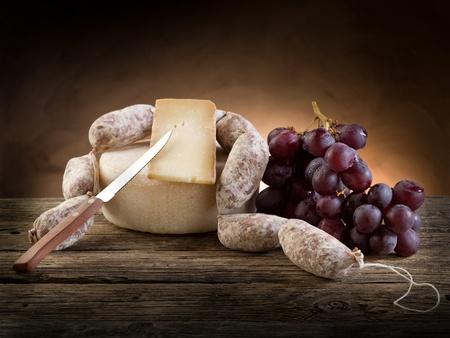 cheese salami and  grapes  photo