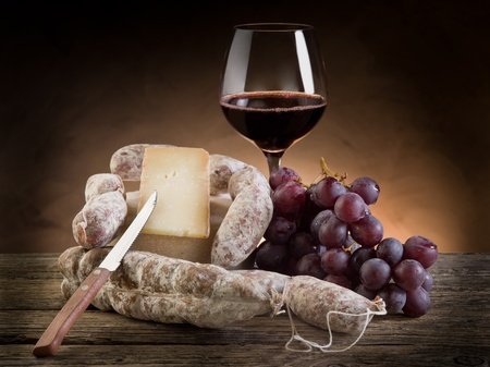 cheese knife: cheese salami grapes and red wine