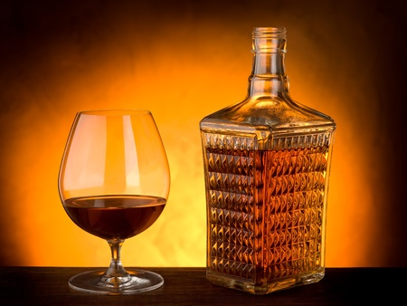 whisky bottle: glass and luxury bottle of liquor Stock Photo