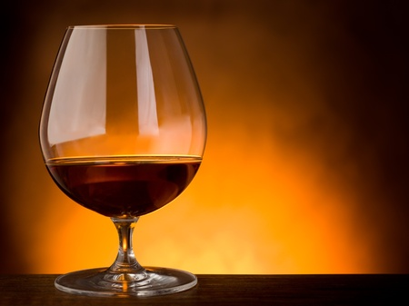 glass  of liquor on wood table with copy space photo