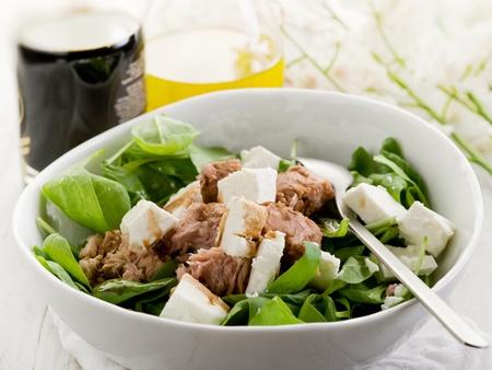mixed salad with fresh spinach tuna and feta cheese photo