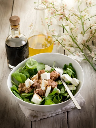 mixed salad with fresh spinach tuna and feta cheese photo