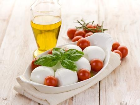 buffalo mozzarella with basil and tomatoes photo