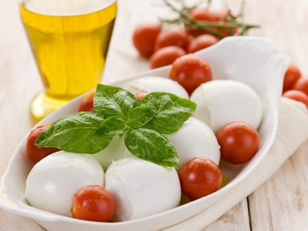 mozzarella cheese: buffalo mozzarella with basil and tomatoes Stock Photo