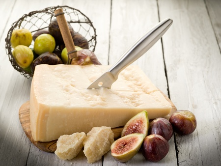parmesan cheese over cutting board and figs Stock Photo - 10508859
