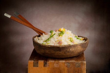 vietnamese food: cantonese rice with chopsticks  on wood background