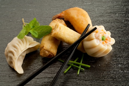 variety of china food on black background