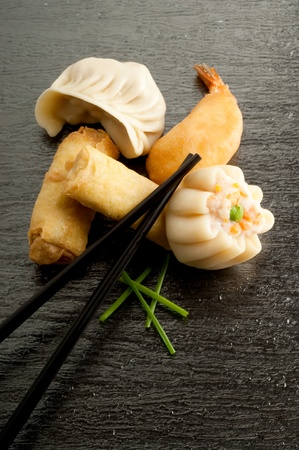 dim: variety of china food on black background Stock Photo