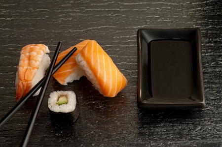 variety of sushi with soy sauce  photo