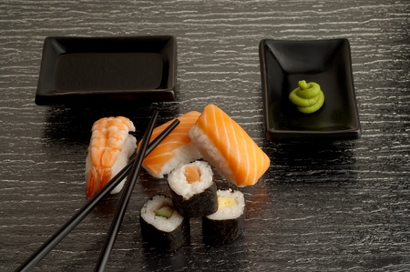 variety of sushi with soy sauce and wasabi photo