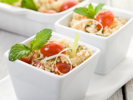 bulgur: vegetable couscous with cherry tomatoes and mint leaf