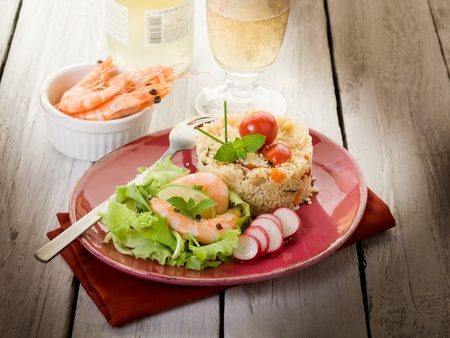 seafood platter: shrimp with salad and vegetables couscous