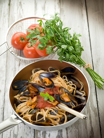 spaghetti with mussels and tomato sauce over casserole Stock Photo - 10591013