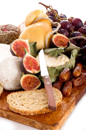 cheeseboard  with an assortment of cheeses  and fruits photo