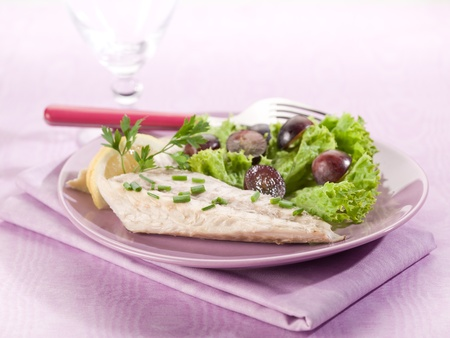mackerel: mackerel fillet with salad and slice grapes over lilac table