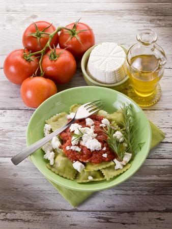 ravioli stuffed with ricotta and spinach garnish with tomato sauce and ricotta photo