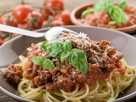 spaghetti bolognese with ragout sauce and parmesan cheese photo