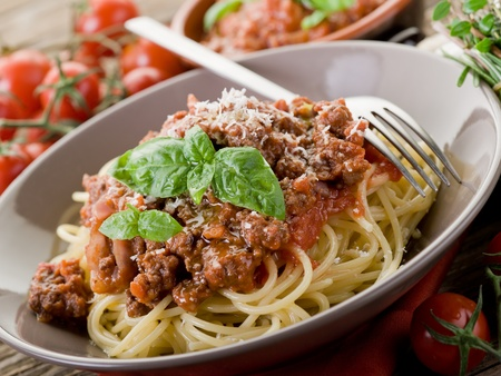 ragout: spaghetti bolognese with ragout sauce and parmesan cheese Stock Photo