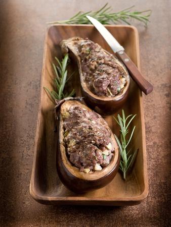 stuffed eggplants on wood dish photo