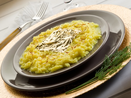 saffron risotto with gold leaf  photo